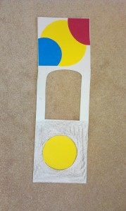 Yellow Back:  Front side: Yellow dot in front with black crayon for lights out. Backside: Big circles of different colors.